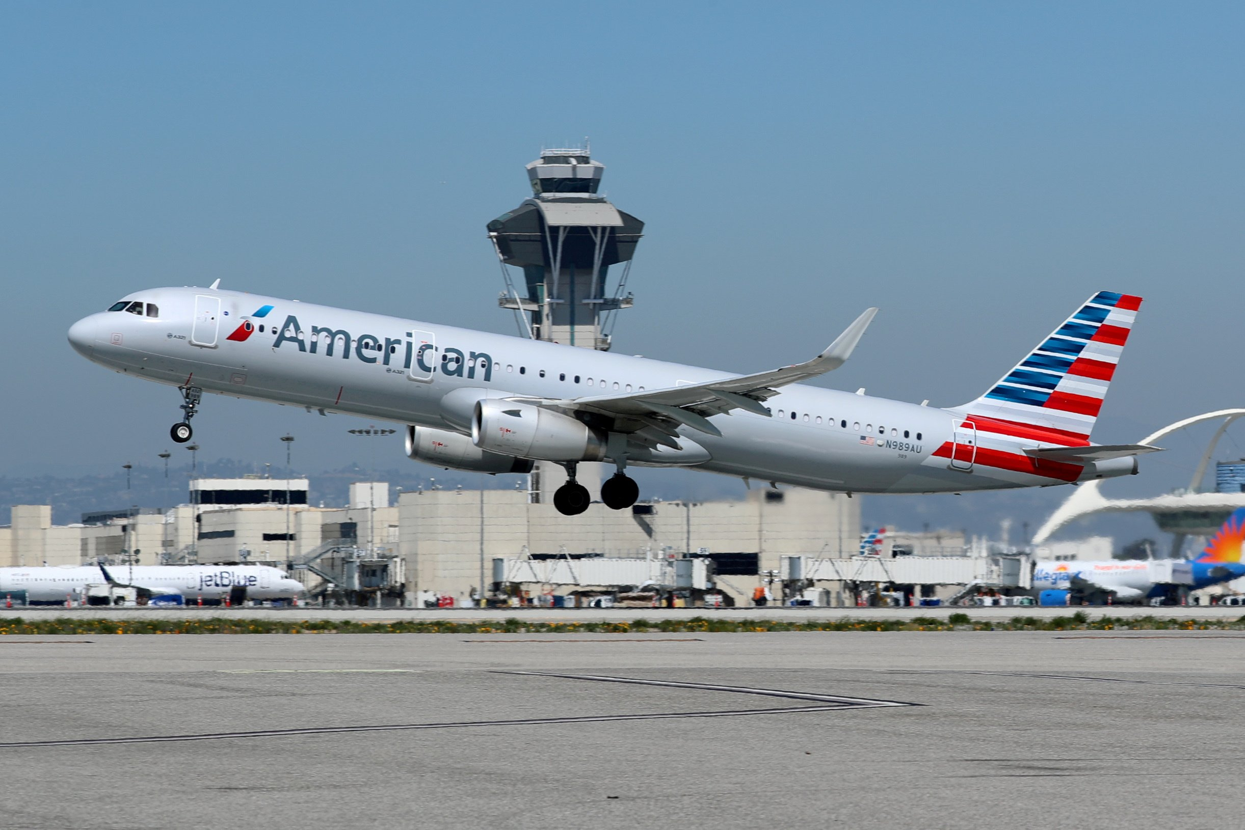 FILE PHOTO: An American Airlines Airbus A321-200 plane takes off from Los Angeles International airport (LAX) in Los Angeles, California, U.S. March 28, 2018. REUTERS/Mike Blake